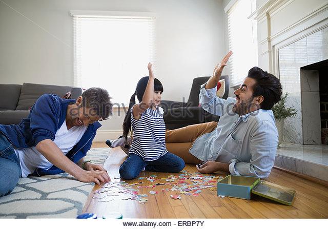 Homosexuelle Paare und Tochter Montage Jigsaw puzzle Stockbild