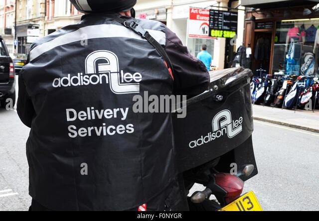 Addison Lee Zustelldienste Auslieferungsfahrer und Fahrrad Stockbild