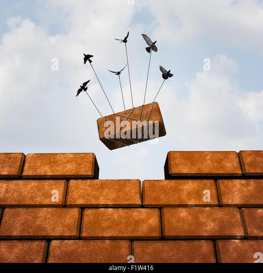 Bauen Sie ein Wand-Business-Konzept als eine Gruppe von Vögel Platzierung einen Stein vervollständigen Stockbild