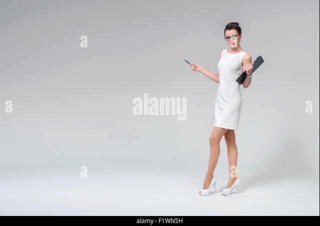 Attraktive Brünette Frau in Business-uniform Stockbild