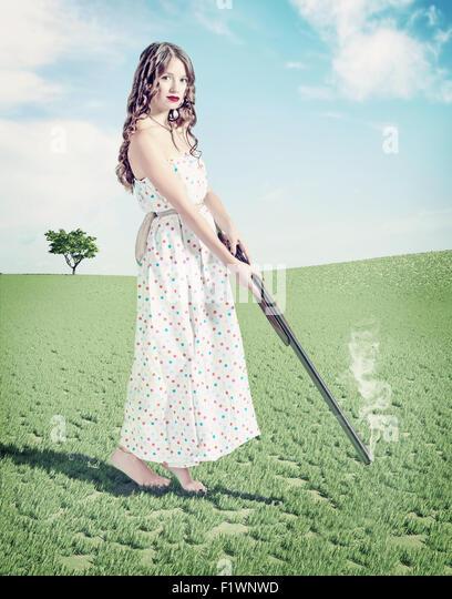 schöne junge Mädchen Jäger. Kreativkonzept Foto- und cg Elemente kombiniert Stockbild