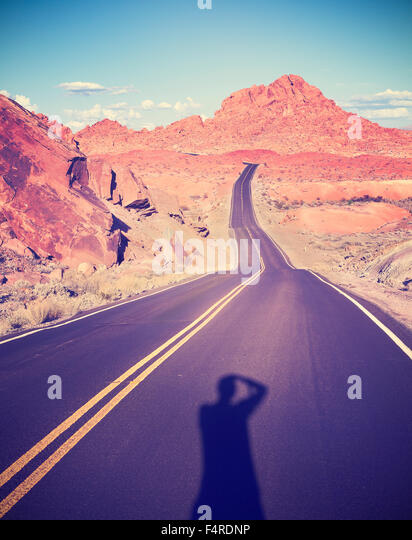 Vintage getönten Schatten eines Fotografen in das Tal des Feuers, Nevada, USA. - Stock-Bilder