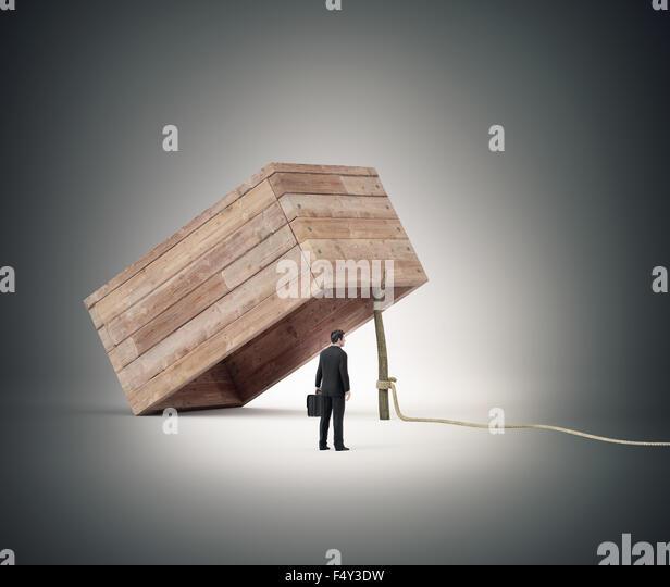 Geschäftsmann Verseilung weiter, um eine Falle Stockbild