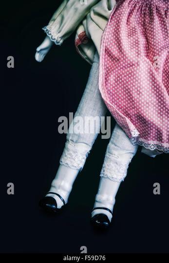 Beine einer Vintage Puppe Stockbild