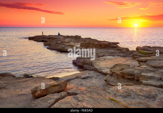 Sonnenuntergang an der Riviera del Corallo, Insel Sardinien, Italien Stockbild