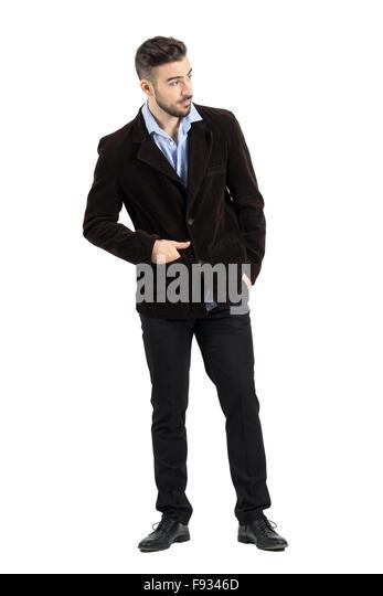 Neugierig beugte sich junge Mode-Modell in Cord Jacke etwas einsehen. Ganzkörper-Länge-Porträt über Stockbild
