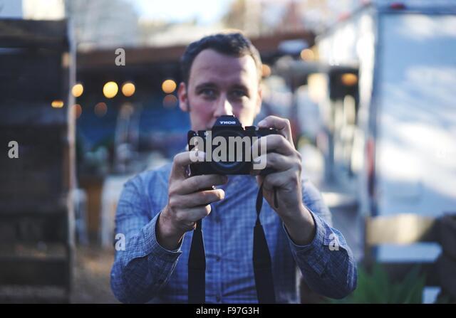 Porträt eines männlichen Fotografen Stockbild