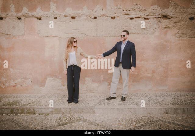 Paar Hand in Hand Stockbild