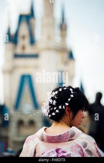 Junge weibliche Asiatin Spaß im Vergnügungspark von Disney World, Orlando Florida - U.S. Stockbild