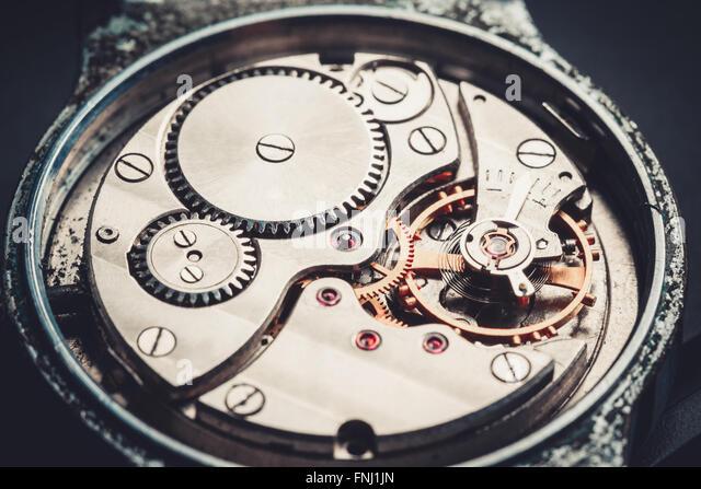 Mechanismus Antik Vintage Armbanduhr schöne Originalhintergrund schwarz-metallic Stockbild