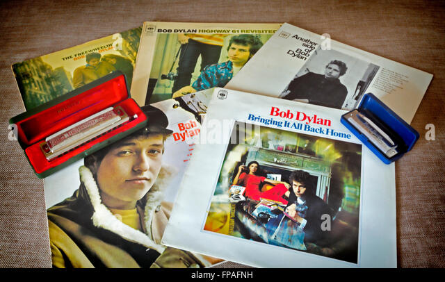 Bob Dylan Record Alben und Mundharmonikas Nostalgie Stockbild