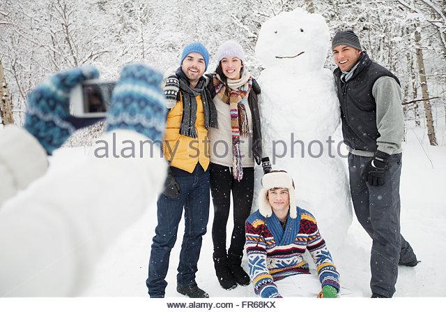 Fotografieren mit Schneemann Stockbild