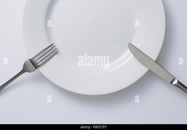 Leeren Teller und Besteck Stockbild