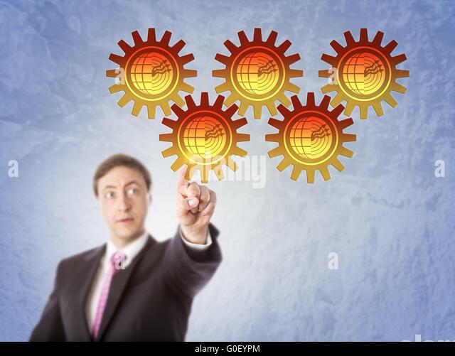Unternehmer, die berühren Geothermie Getriebeantrieb Stockbild