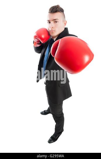 Selbstbewusst und wettbewerbsfähigen Geschäftsmann Stanzen die Kamera mit rote Boxhandschuhe Stockbild