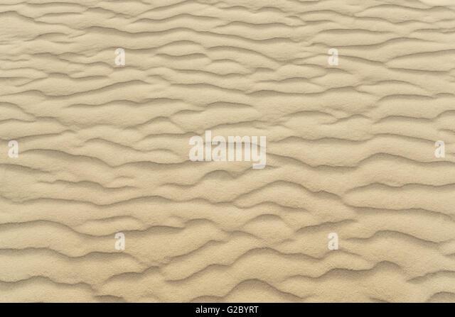 Wellen der Strand Sand Textur und Hintergrund Stockbild