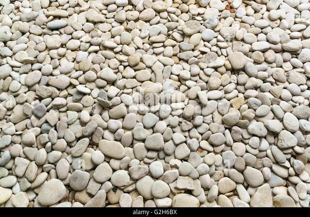 Weißen glatten Steinen Schuss von oben für den Hintergrund. Stockbild