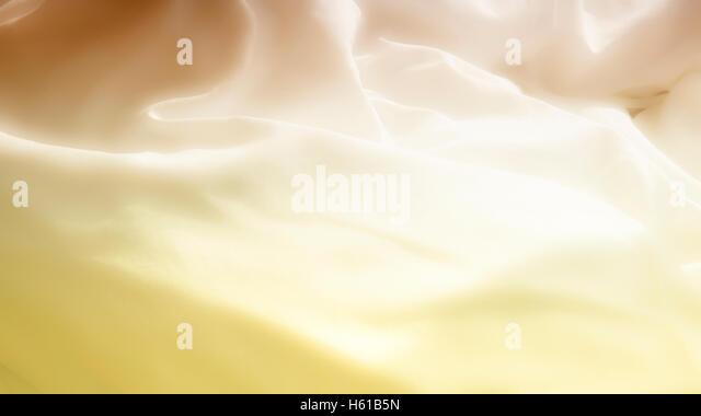 Nahaufnahme von weichen weißen Bettwäsche in gelbes Licht Stockbild