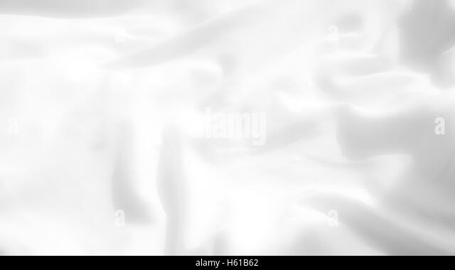 Nahaufnahme von weichen weißen Bettwäsche im Morgenlicht Stockbild