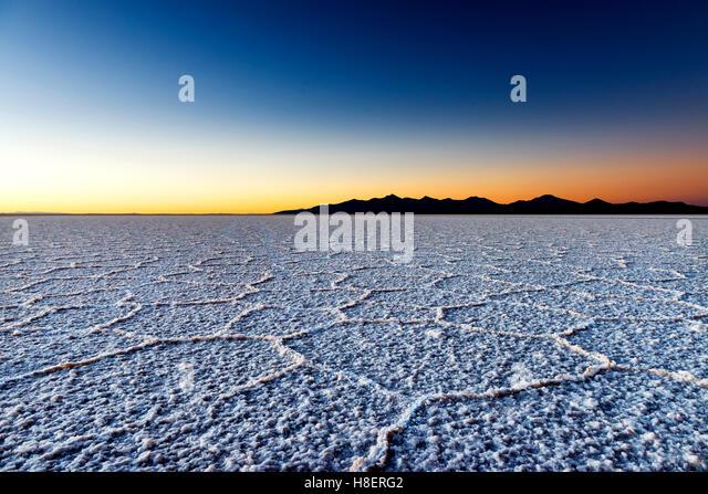 Sonnenaufgang auf dem Salar de Uyuni in Bolivien, Südamerika; Konzept für Reisen in Bolivien und Südamerika Stockbild