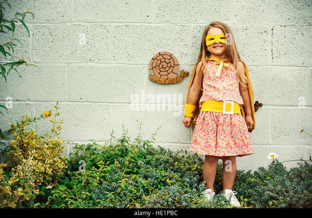 Superheld Baby Mädchen mutig liebenswert Konzept Stockbild