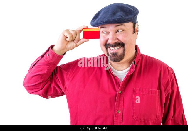 Fröhlichen Mann betrachtete seine Kreditkarte mit einem strahlenden Lächeln der Vorfreude, wie er all Stockbild