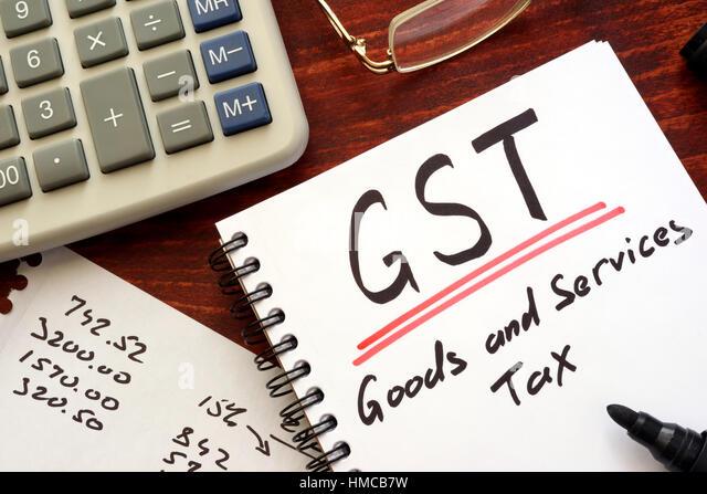 Die Mehrwertsteuer (GST) in eine Notiz geschrieben. Stockbild