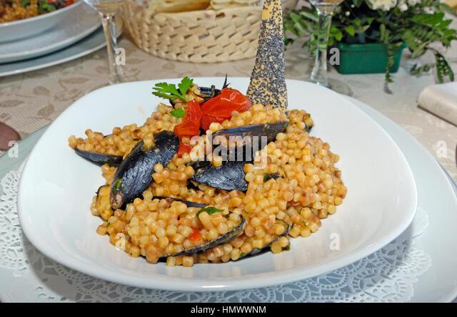 Fregola, Hartweizen Weizen Grieß Nudeln aus Sardinien, Italien Stockbild