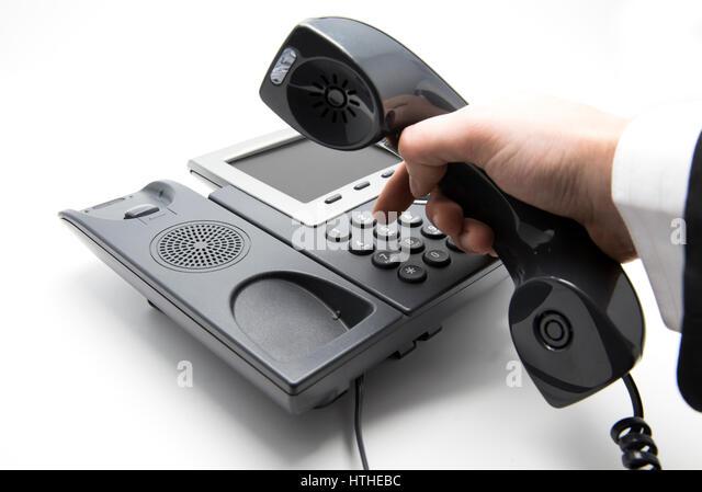 Tätigen von anrufen, ist Geschäftsmann Telefontastatur IP-Einwahl Stockbild