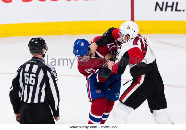 Montreal, Quebec, Kanada. 19. März 2017. Ottawa Senators Chris Kelly (22) und Montreal Canadiens Torrey Mitchell Stockbild