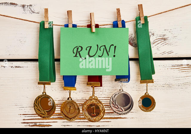 Motivation-Karte und Medaillen. Stockbild