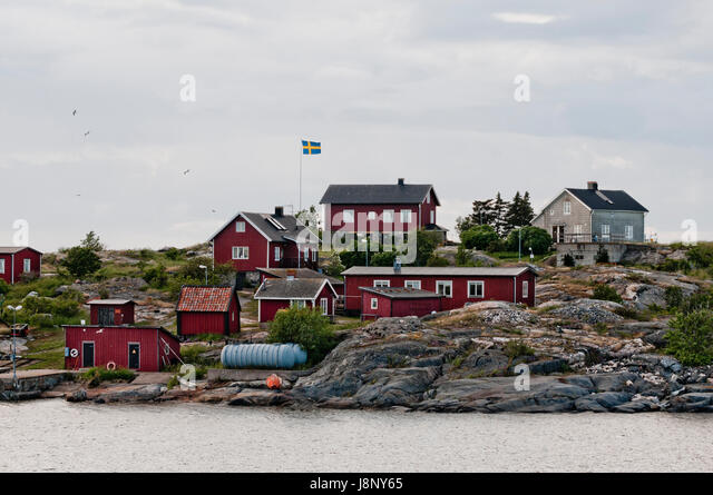 Kleine Häuser auf dem Seeweg Stockbild