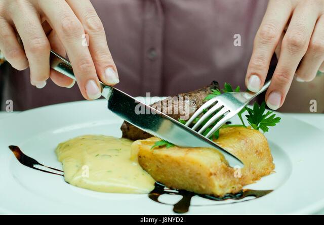 Frau, Essen Stockbild