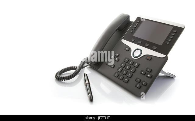 Moderne Business Office IP-Telefon mit Stift auf weißem Hintergrund Stockbild