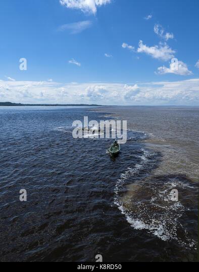 Gewässern des Amazonas und Rio Negro, Amazonas, Manaus, Brasilien Stockbild