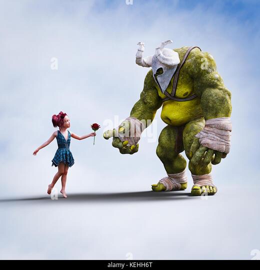 Mädchen Blume, die auf den riesigen Ogre Stockbild