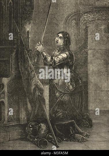 Jeanne d'Arc in der Rüstung kniete im Gebet Stockbild
