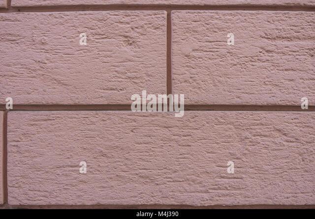 Farbige Steine von einer Hauswand. Stockbild