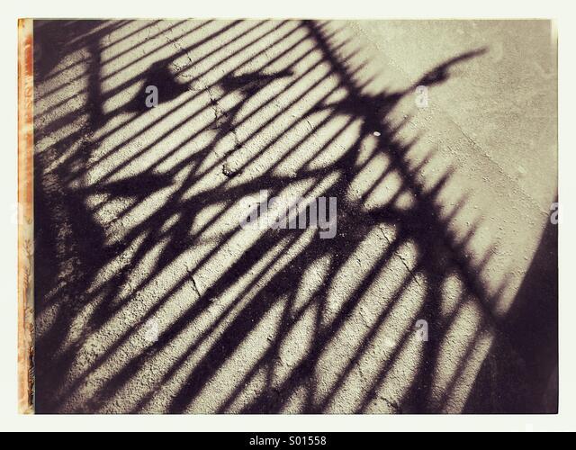 Schatten eines Fahrrades an Universität Stadt Oxford Großbritannien Stockbild