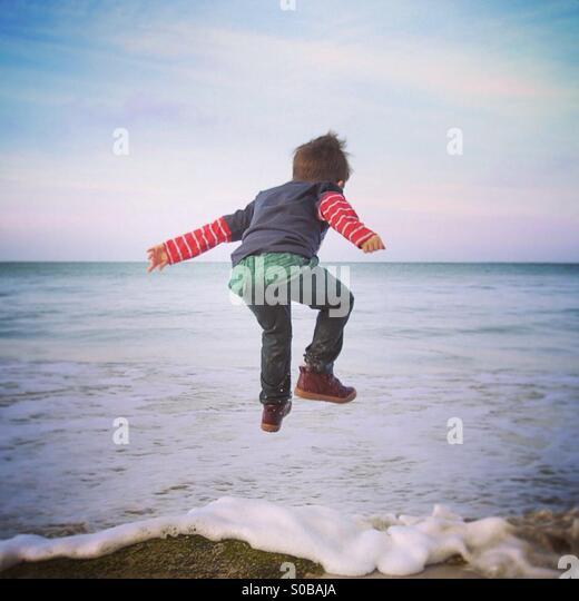 Sprung vor Freude Stockbild