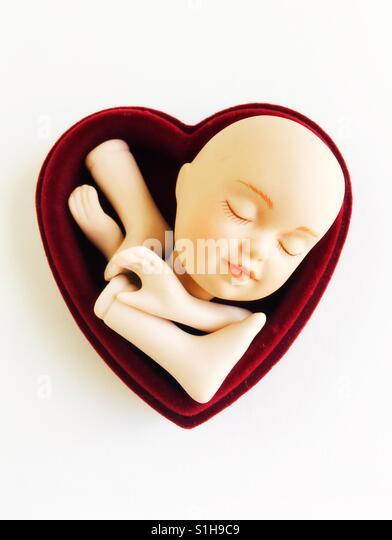 Ein Herz mit Puppenteile. Stockbild