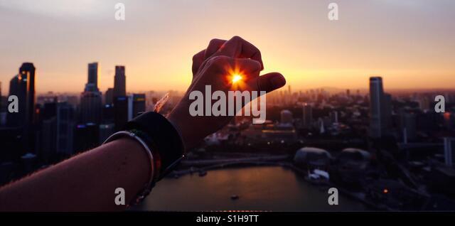 Fang die Sonne in Singapur Stockbild