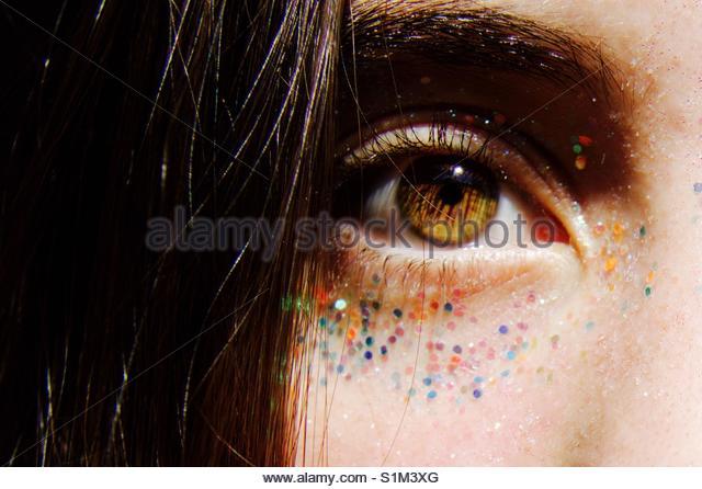 Glitzernde Augen schließen Stockbild