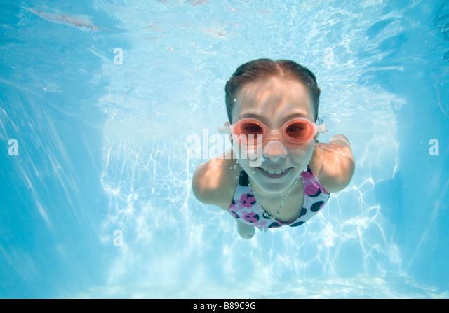 Girl swimming underwater Photo Stock