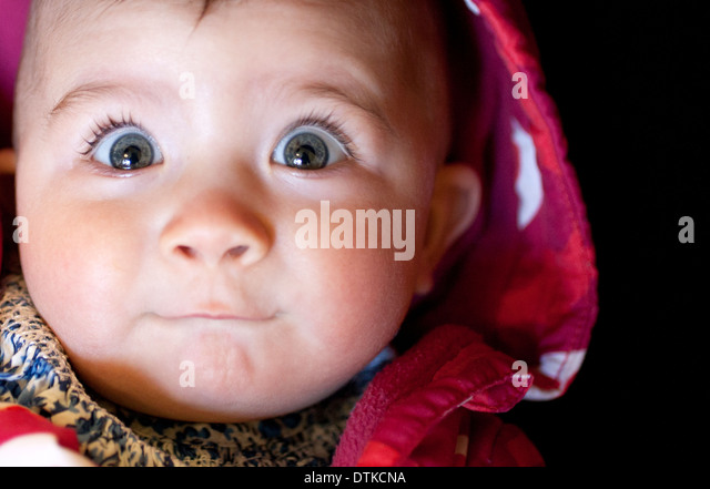 Close up of baby girl's surpris face Photo Stock