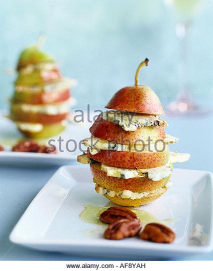 Pera con formaggio blu e olio di noci Immagini Stock