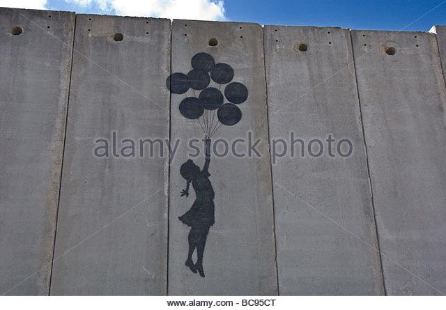 Uma pintura sobre a parede Separartion israelita em Jerusalém Oriental, perto da fronteira com a Ramallah. Imagens de Stock