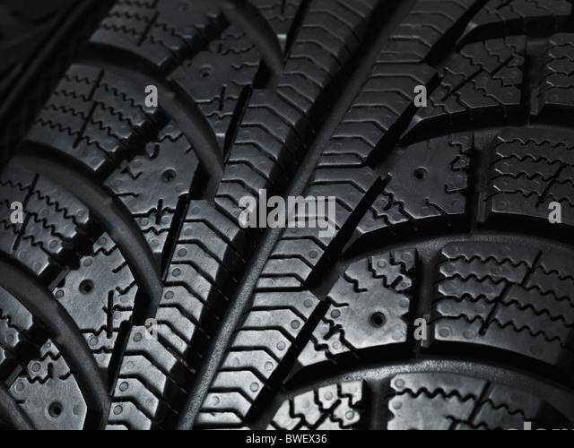 Close-up de um inverno aluguer de textura da bitola do pneu Imagens de Stock