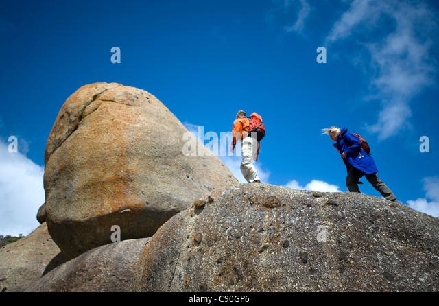 Rochas de granito, Whisky Bay, Parque Nacional Wilsons promontório, Victoria, Austrália Imagens de Stock
