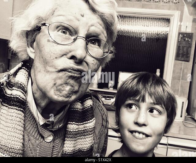 Old lady and young lad Imagens de Stock